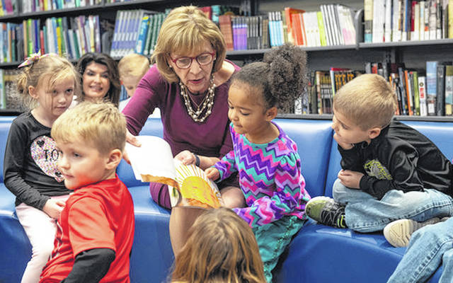Submitted photos First Lady Fran DeWine, a Cedarville resident, reads to kids at a library in Lawrence County.