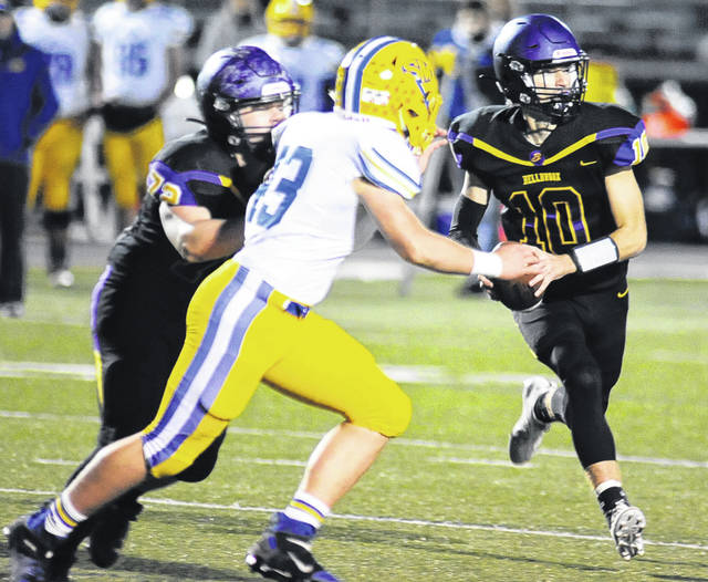 Photos by Charles Caperton | Greene County News Bellbrook quarterback Alex Westbrock gets ready to pitch the ball as a St. Marys Memorial defender closes in.