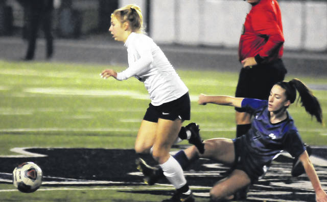 Photos by Charles Caperton | Greene County News Bellbrook's Leila Donnerberg jumps a slide tackle by Miamisburg's Kayla Gieszl during the first half of a Division-I district semifinal in Xenia Tuesday.