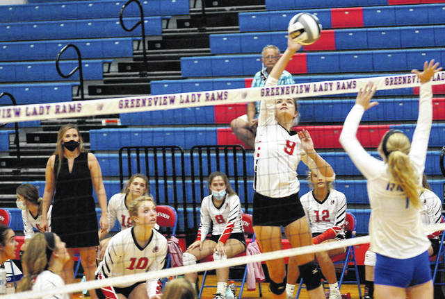 File photos Cedarville senior Bethany Stevenson goes for the kill against Greeneview.