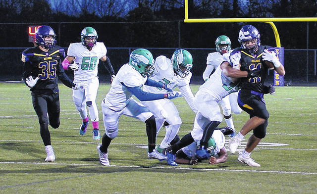 Barb Slone | Greene County News Bellbrook's Taylor Jordan tries to escape from some Chaminade-Julienne defenders during a Division-III football playoff game Friday. He ran for 87 yards and a score and also caught a touchdown pass.