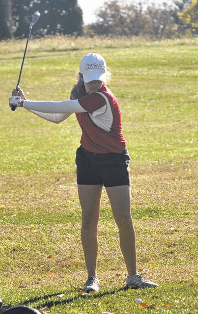 Carroll junior Sarah Ochs takes a practice swing before hitting into the first green.
