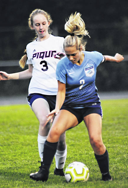 Photos by Charles Caperton | Greene County News Fairborn junior Erin Thomas beats Piqua's Rachel Cavendar to the ball during a soccer match earlier this fall. Thomas switched from a defensive position to an offensive position and has become one of the top scorers in the Miami Valley League.
