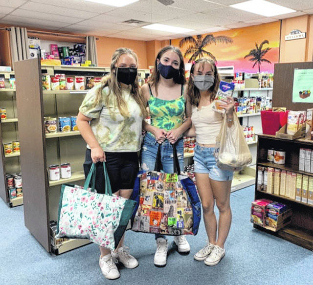 Bellbrook Hope Squad co-founders Hailey Bridges, Zoya Bessler, and secretary Ally Lewis work the food drive.
