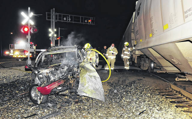 Charles Caperton   Greene County News A vehicle was struck by a northbound train Wednesday night, Oct. 14, at Kauffman and South Central avenues in Fairborn. The vehicle owner reportedly called police after his minivan broke down at the rail crossing. Police notified the rail carrier of the situation but the freight train was unable to stop in time. Just after 10 p.m., the train struck the vehicle on the right front side causing a fire to erupt. Fire crews extinguished the fire. No injuries were reported.