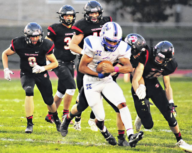 Charles Caperton | Greene County News Xenia quarterback Tremell Wright runs the ball through the Tecumseh defense during last week's playoff victory. Wright took over as QB in week four and has the offense clicking.