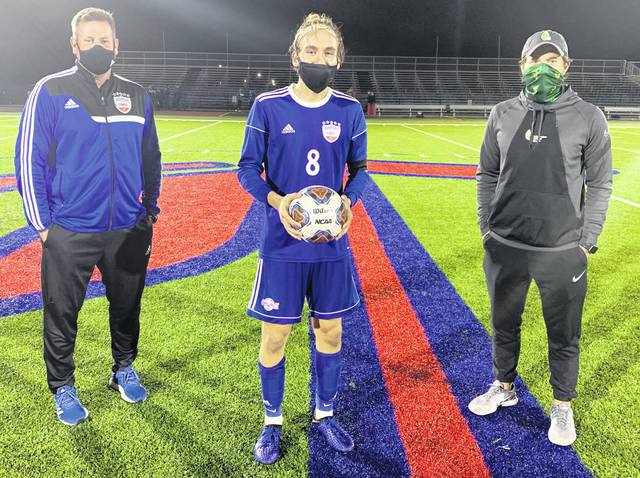 Photo courtesy Carroll High School Athletic Department Carroll's Conner Osterholt set the Carroll record for career goals. He is shown with Coach Scott Molfenter (left) and former record holder Alex Van Der Sluijs.