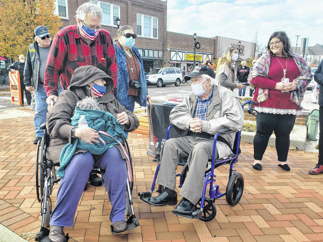 World War II veteran Herman Holt converses with residents during Fairborn's Veterans Day ceremony.