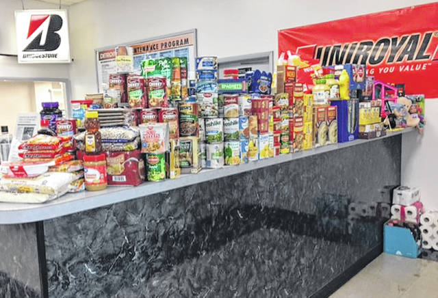 Barbara VandeVenter | Greene County News Nonperishable food items and a few toiletries pile up at Detroit Tire in Xenia. The community donations for Xenia students were picked up Monday, leaving room for more until the holidays are over.