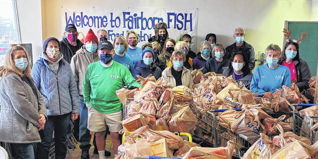 Volunteers at Fairborn FISH food pantry gear up to distribute Thanksgiving meals to 650 local families.