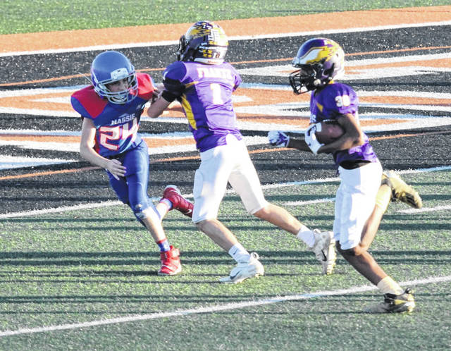 Bellbrook's Dion Casey runs for the end zone against Clinton Massie.