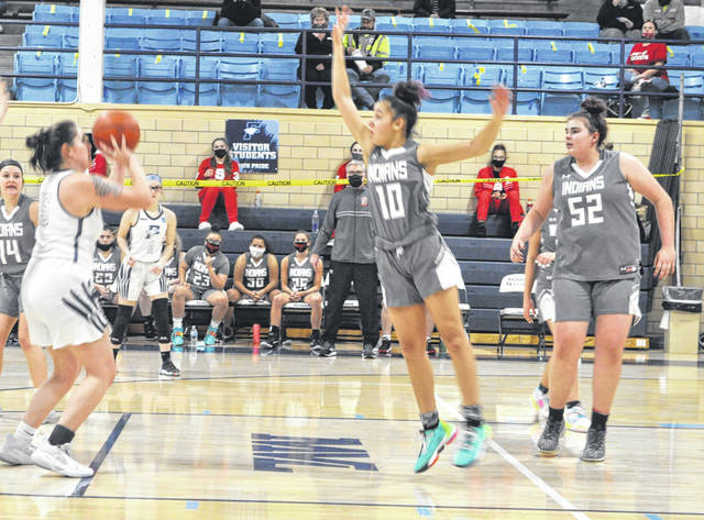 Senior Cassidy Mustard takes a shot during the first quarter Wednesday.