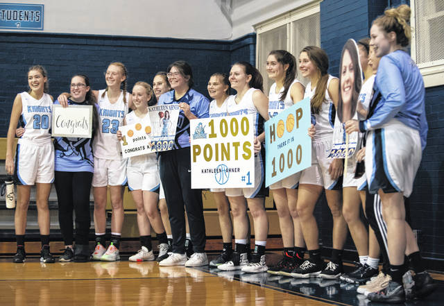 Members of the Legacy Christian girls basketball team pose for a picture after the win against Carlisle, during which Kathleen Ahner scored her 1,000th career point.