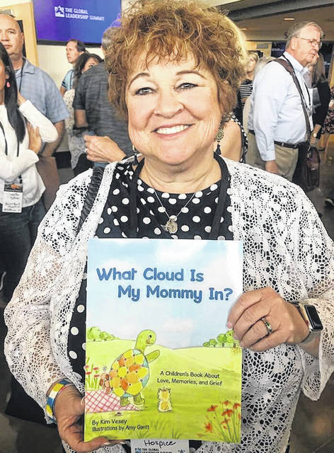 "Submitted photos Beavercreek resident Kim Vesey shows off her first book, ""What Cloud Is My Mommy In?"