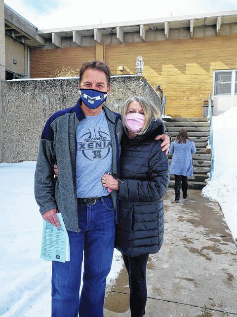 Xenia teacher Kent Anderson and his, LuAnn, wife outside Fairborn High School after getting the vaccine.
