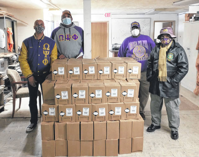 Darryl McGee | Greene County News Marc Dunston, CEO of Just Social Solutions and a member of the the Mu Chi chapter of the Omega Psi Phi fraternity, donated a pallet of hand sanitizer to Wilberforce University Monday. Dunston's goal is to donate 100 pallets to 100 Historically Black Colleges and Universities. Pictured (alphabetically) are Odell Graves, chapter president Samuel Jackson, Don Jones, and Eric Salter.