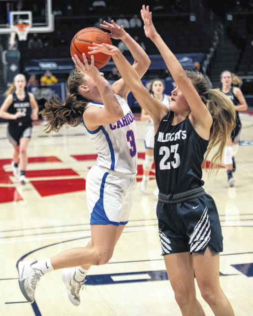 Photos by Grace Wilson | Greene County News Carroll's Sarah Ochs shoots while Napoleon's Kalli Helberg goes for the block during the Division-II state semifinals at University of Dayton Arena Friday. Napoleon won, 46-43.