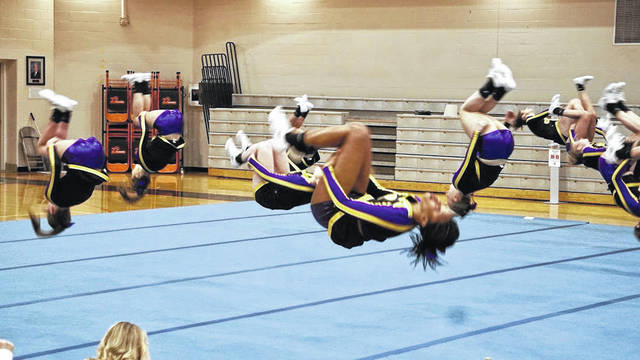 The Bellbrook High School competition cheerleading squad performs during a competition.