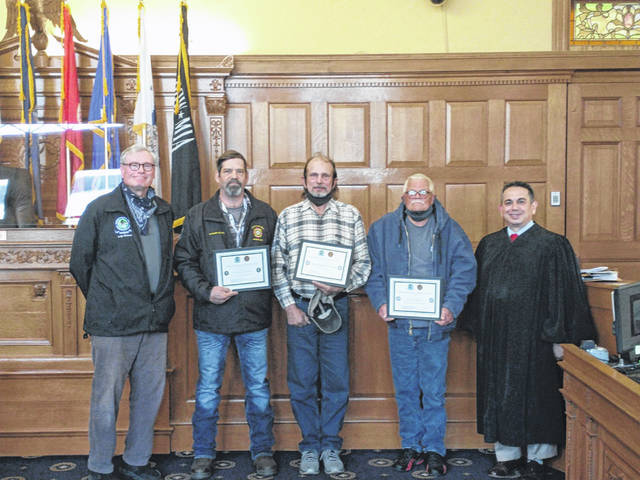 Chris Stauter, Paul Stark, and Trent Winslow show off their certificates after graduating from Greene County Veterans Court Friday. They are pictured with Retired Judge Stephen A. Wolaver (left) and Common Pleas Court Judge Adolfo Tornichio (right).