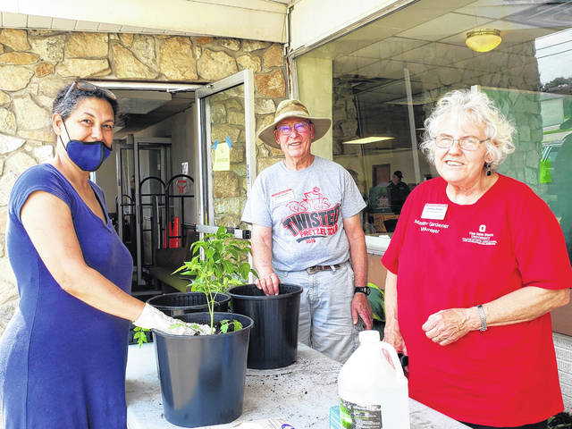Photos by London Bishop   Greene County News Amira, a Fairborn resident, and master gardeners Garry Abfalter and Denise Wetzel.