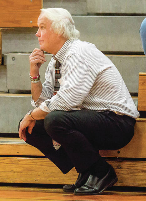 File photos Beavercreek girls coach Ed Zink in one of his four famous stances: The squat.