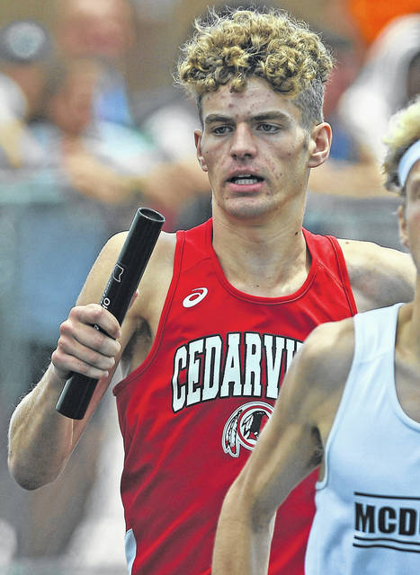 Photos by Richard Parrish | The Lima News Cedarville's Trent Koning runs the first leg of the 3,200 meter relay during Friday's OHSAA Division III State Track and Field Championships at Westervillle North High School. Cedarville was fourth in 8:02.80.