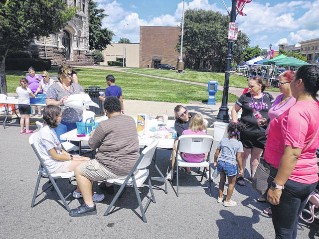 Photos by Darryl McGee | Greene County News Community members partake in Xenia's Red, White, & Blue Block Party festivities Firday.