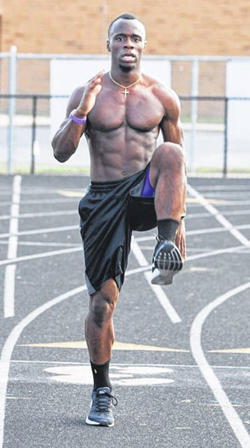 Dekan Ekpo works out at Beavercreek High School between his freshman and sophomore years at TCU. He trimmed down and became one of the school's top sprinters.