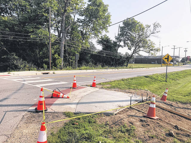 Submitted photos The construction of a series of sidewalks from Wilberforce University's Alumni Multiplex on North Bickett Road leading to U.S. 42 is underway. The project is scheduled to be finished Aug. 7.