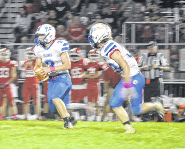 Greeneview juniors Cole Dehaven (3) and Rylan Hurst (33) run the option against Cedarville on Friday. The Rams won the Battle of 72 for the eighth straight meeting.