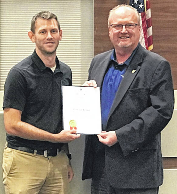 Submitted photo Xenia recently received the Auditor of State Award with Distinction for 2020. Pictured, Finance Director Ryan Duke (left) shows off the award with Joe Braden, West Regional liaison for Ohio Auditor of State Keith Faber.
