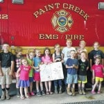 4-H members present firefighters with cookies, cards