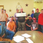MNB donates grill to Cattlemen