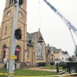 Old bell comes down