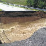 Flooding washes out road section