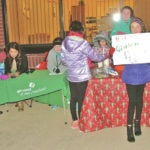 Girls Scouts help with First Friday