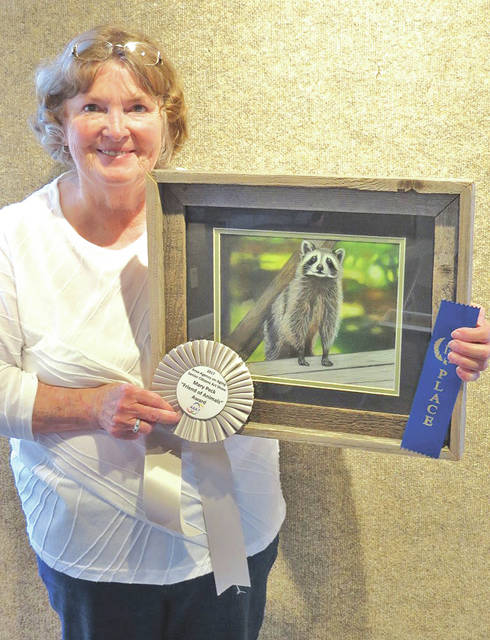 "One of the top winners at this year's AAA7 35th annual Senior Citizens Art Show was Cheryl Collier from Highland County, who won the Mary Peck Friend of Animals Award for her pencil piece, ""Curious Raccoon."""