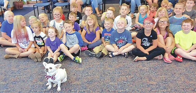 Greenfield library summer reading program participants are shown doing their best Homer the Dog imitation after Homer and his mom visited the Greenfield Branch Library and explained to the children how to be good citizens.