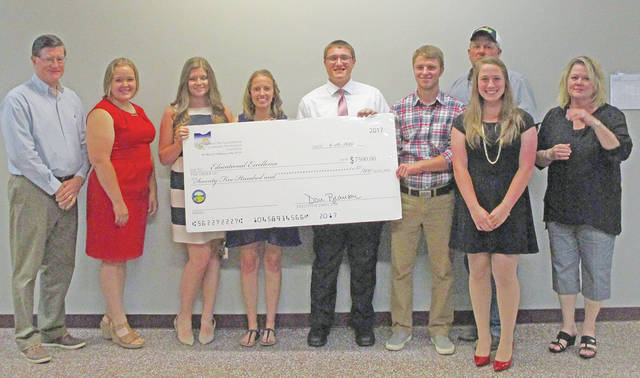 The Southern Ohio Agricultural & Community Development Foundation recently recognized the recipients of the 2017-18 Educational Excellence Competitive Grant, a one-time grant of up to $7,500 for college upper classmen to be used toward tuition, on campus housing and lab fees at an accredited institution. Applicants were scored by a committee on a combination of written essays and personal interviews. Highland County winners and SOACDF staff members are pictured, from left, Don Branson, SOACDF executive director; Lauren Grover; Caitlyn Arledge; Ragan Bohrer; Cole Schaefer; Klay Walker; Eric Wolfer, SOACDF board member; Emily Burwinkel; and Kelly Cole, SOACDF Education Committee chairperson. For more information about SOACDF programs, visit www.soacdf.net.