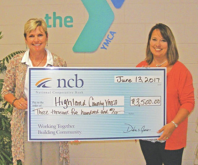 NCB recently donated $3,500 to the Highland County YMCA. The donation will be used to support the Y's youth programming, including youth sports and summer camp. Pictured are Deb Jones, NCB Ohio co-president. and Kellie Kiser, associate executive director of the Highland County YMCA.