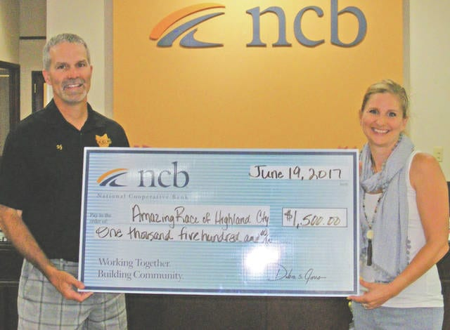 NCB recently donated $1,500 to the Amazing Race of Highland County, an organization was formed in 2013 to help support the organizations, charities, churches and sports teams of Highland County. One hundred percent of the profits from the race are donated to community non-profit organizations. Pictured are Dr. David Jamieson, Amazing Race committee chairman, and Mary Alice Hartley, NCB vice president and customer service loan manager.