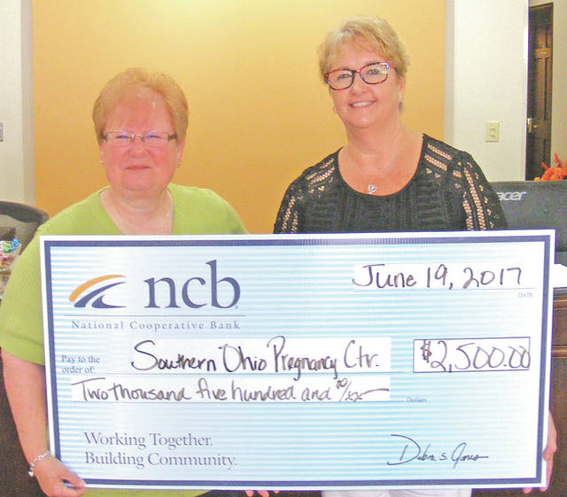 NCB recently donated $2,500 to the Southern Ohio Pregnancy Center in Hillsboro. The donation will be used for the parenting program, which provides classes to first-time parents. Pictured are Cathy Griffith, SOPC director; and Tammy Irvin, NCB regional branch manager.