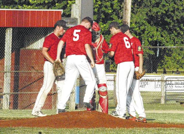Members of Hillsboro American Legion Post 129's baseball team gather around the pitchers mound on June 16 after warm-ups.