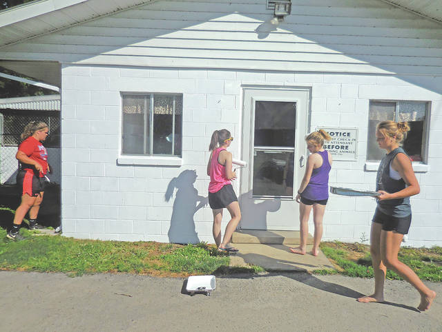 Hillsboro High School National Honor Society students recently volunteered their time and effort to paint the Highland County Humane Society Animal Shelter. The Humane Society said to would like to thank them for a job well done. The four girls in one picture, from left, are Riley Moberly, Emily King, Emily Young and Ashleigh Baucom. Painting in the other picture is Britton Haines.