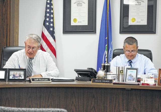 Highland County Commissioner Jeff Duncan and board of commissioners president Shane Wilkin sit in session during a Wednesday commissioners meeting.