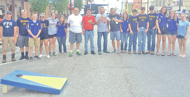 "On July 8 Hillsboro FFA members hosted their annual cornhole tournament at the Festival of the Bells. The members helped set up cornhole boards and kept track of scores for the participants. Lexey Hetzel said ""it went smoothly and was a great experience for the new officers and members."" Twenty-two teams signed up to play. First, second and third place each received money for placing in the top three at the tournament. The rest of the proceeds go to the Hillsboro FFA chapter. The first place team was Sean Short and Jay Dotson. Second place was Gary and Ron. Pictured, from left, are Joe Helterbrand, Ryan Harless, Grant Crum, Jessica Moon, Heather Burba, Kirsten Harp, Gary, Ron, Jay Dotson, Sean Short, Jordan Williamson, Riley Burba, Casey Jordan, Spencer Rudy, Taylor Chaney, Kennedi Claycomb and Hannah Oyer."