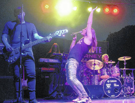 Absolute Journey Tribute lead singger Riccardo Curzi points to the sky on Saturday night in Greenfield at the Greene Countrie Towne Festival.