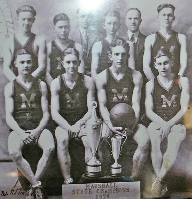 The 1928 State Basketball Champion Marshall High School Red Flashes pose with the state championship trophy. Front row, L to R: Hubert McCoy, Olin Brooks, Lowell Smith, Joe Vanzant. Second row, L to R: Delbert Fawley, Kenneth Bumgarner, Lloyd Chestnut, Archie Gilletly. Back row, L to R: Snag Emery (Coach), Leo F. Hodgson (Supt.).