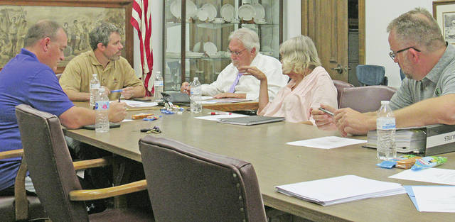 Pictured during Thursday's Greenfield School Board meeting are (l-r) board member Jason Allison, board president Eric Zint, district treasurer Joe Smith, and board members Marilyn Mitchell and Doug Mustard.