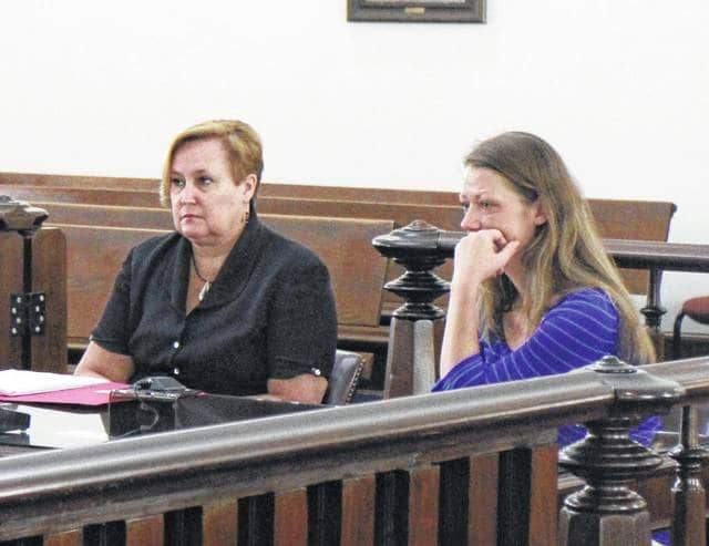 Jessica Colville, right, sits in court with defense attorney Kathryn Hapner during a Wednesday hearing.